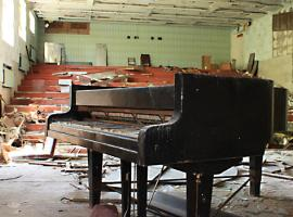 Piano in abonded room in post-nuclear catastrophe city Pripyat (in Ukraine)
