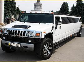 Outdoor view on white Hummer limousine