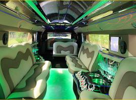 Multicolored interior of limousine with bar