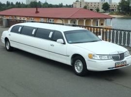 Stretched white limousine in Kyiv's riverbank